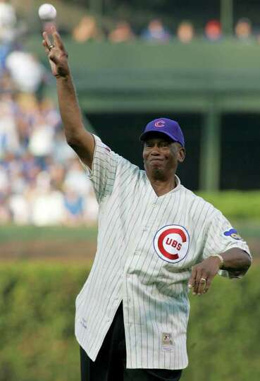 Chicago Cubs great Ernie Banks throws out the ceremonial first pitch before Game 3 of the MLB Nation