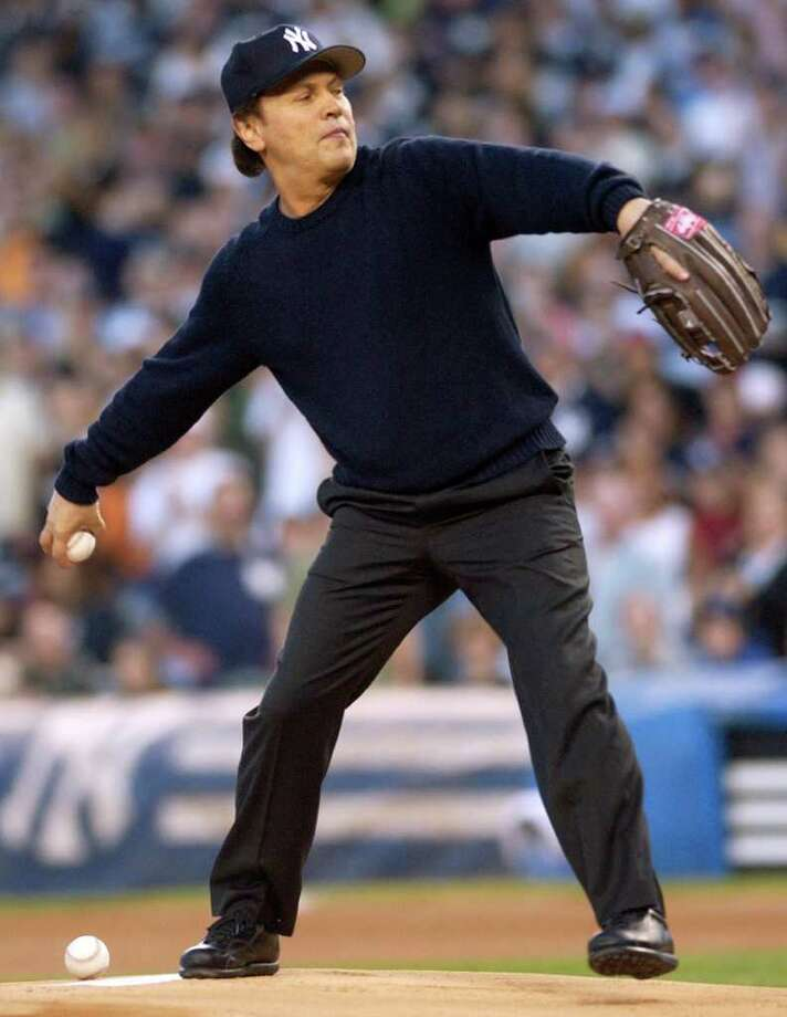 ** FILE ** In this May 29, 2005, file photo, Billy Crystal throws out the first pitch before the Boston Red Sox beat the New York Yankees, 7-2, at Yankee Stadium in New York. The actor will sign a minor league contract with the New York Yankees and play in Thursday's exhibition game against the Pittsburgh Pirates. Photo: Bill Kostroun, AP / AP
