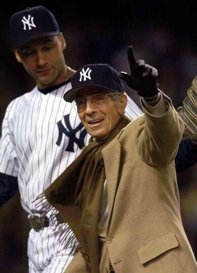 ** FILE ** Phil Rizzuto, right, waves to the crowd as Yankees shortstop Derek Jeter looks on, after