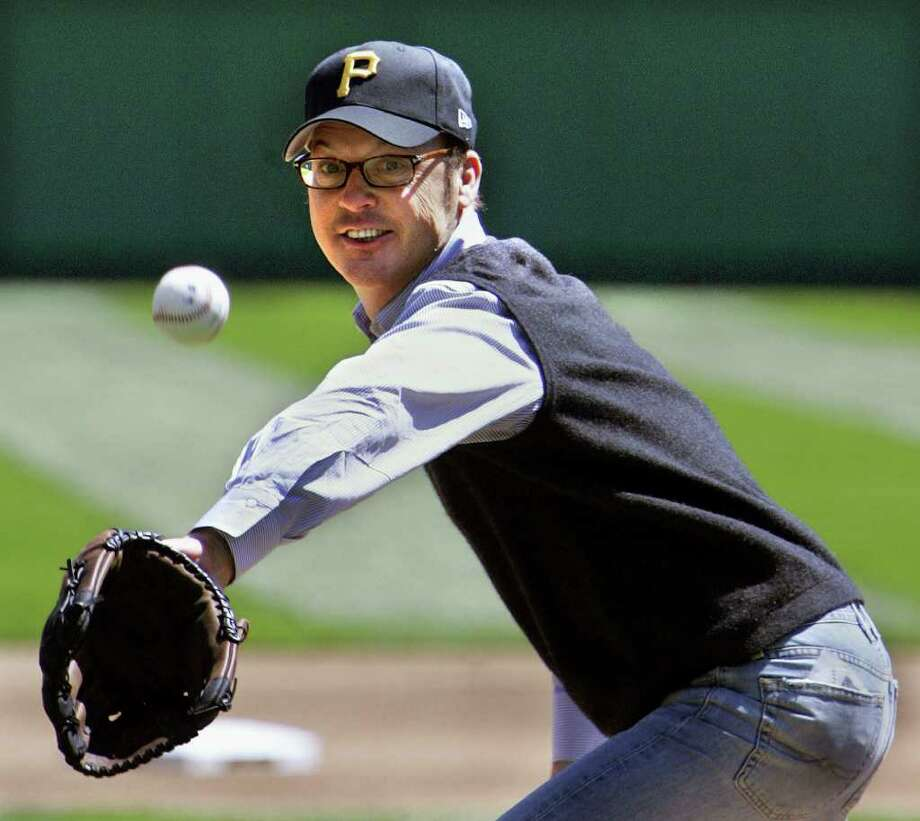Actor Michael Keaton, who grew up in Pittsburgh, gets a second try at throwing out the first pitch before the Pittsburgh Pirates home opener against the Los Angeles Dodgers in Pittsburgh, April 10, 2006. The Dodgers beat the Pirates 8-3. Photo: GENE J. PUSKAR, AP / AP