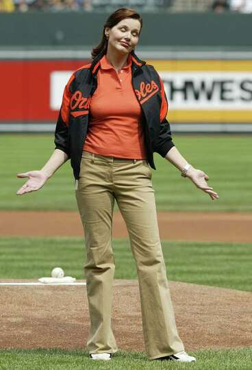 Actress Geena Davis reacts after throwing out the first pitch before the start of the Baltimore Orio
