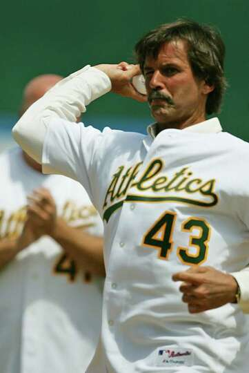 Former Oakland Athletics pitcher and Hall of Famer Dennis Eckersley throws out the first pitch prior