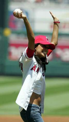 """Eva Longoria perpares to throw out the first pitch at the New York Yankees Los Angeles Angels game in Anaheim Calif., on Sunday, July 24, 2005. Longoria is an actress who currently stars in the television show """"Desperate Housewives"""". Photo: CHRIS CARLSON, AP / AP"""