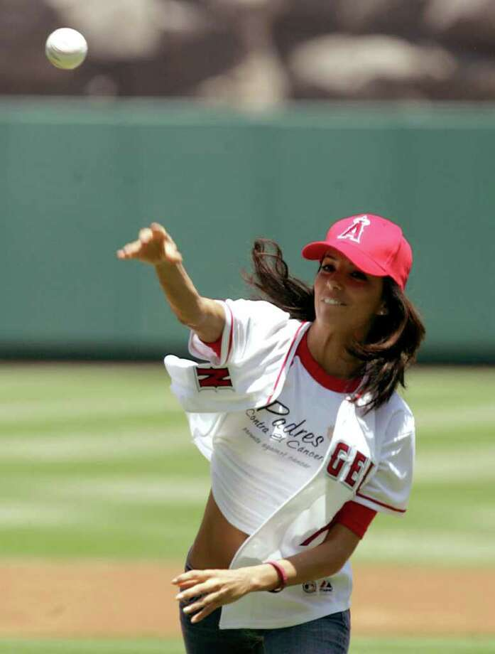 """Eva Longoria throws out the first pitch at the New York Yankees Los Angeles Angels game in Anaheim Calif., on Sunday, July 24, 2005. Longoria is an actress who currently stars in the television show """"Desperate Housewives"""". Photo: CHRIS CARLSON, AP / AP"""