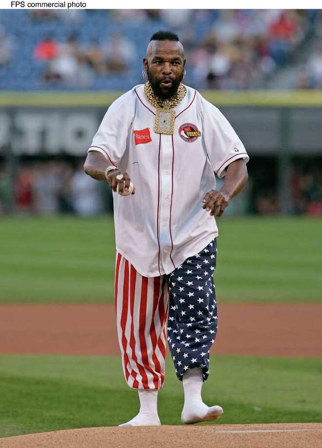 To launch Hanes Double Tough Socks, Mr. T throws out the first pitch to Hall of Fame catcher Carlton Fisk at the Boston Red Sox Chicago White Sox game, at US Cellular Field, Friday, July 22, 2005, in Chicago. Mr. T did not need to wear his shoes because Hanes' new socks have double the reinforcement in the heels and toes, giving the tough guy great form and comfort on the mound. (Feature Photo Service) Photo: BRIAN KERSEY, FPS / HANES