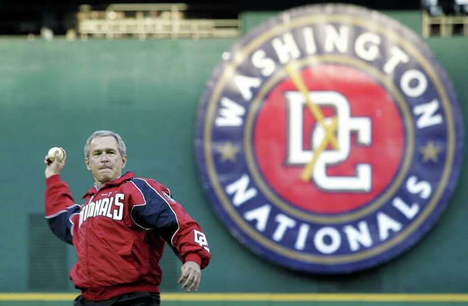 President Bush throws out the first pitch at RFK Stadium in game between the Washington Nationals and Arizona Diamondbacks, Thursday, April 14, 2005, in Washington. It's the Nationals first regular-season baseball game in the nation's capital in 34 years. Photo: LAWRENCE JACKSON, AP / AP