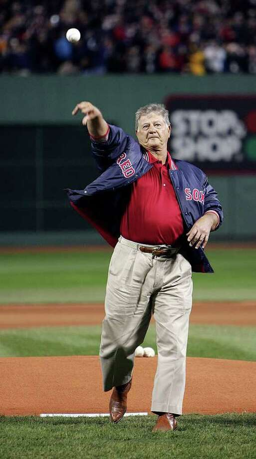 Former Boston Red Sox player Carl Yastrzemski throws the ceremonial first pitch in Game 1 of the World Series between the Red Sox and St. Louis Cardinals at Fenway Park in Boston on October 23, 2004. Photo: MIKE SEGAR, AP / AP
