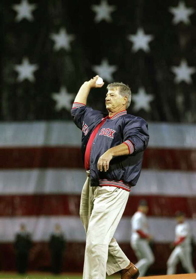 Carl Yastrzemski  throws in the first pitch during game 1 of the World Series at Boston's Fenway Park Saturday, Oct. 23, 2004. Yastremski is a former Red Sox great. Photo: ELISE AMENDOLA, AP / AP