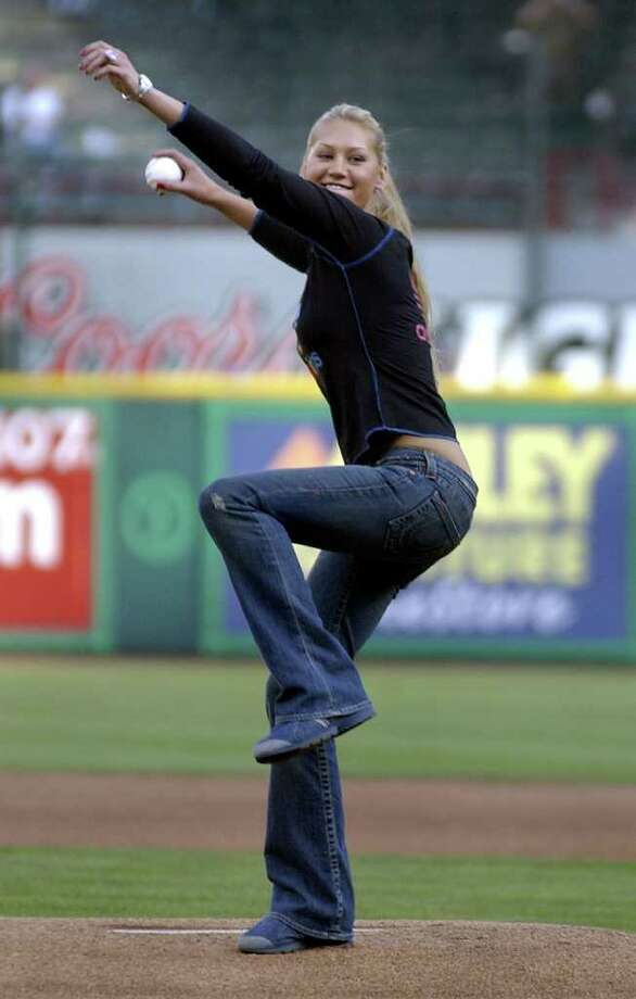 Tennis star Anna Kournikova winds up to deliver the honorary first pitch prior to the start of the game against the Kansas City Royals, Tuesday May 18, 2004, in Arlington, Texas. Photo: TONY GUTIERREZ, AP / AP