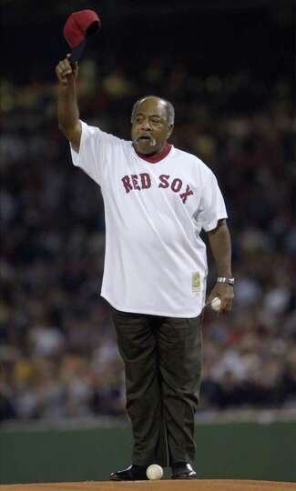 Former Boston Red Sox pitcher Luis Tiant tips his cap to the crowd Monday, Oct. 13, 2003 prior to th