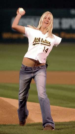 Bethany Hamilton, 14, of Kauai, Hawaii, throws out the ceremonial first pitch prior to the start of