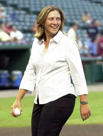 LPGA Golfer Angela Langford  walks off the field after throwing out the ceremonial first pitch prior