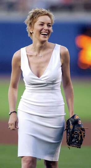 Actress Sharon Stone smiles after throwing the first pitch before the Cincinnate Reds play the Los A