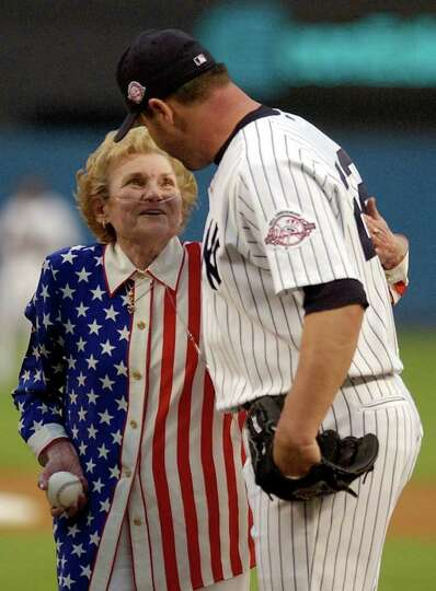 Bess Clemens looks up at her son New York Yankees pitcher Roger Clemens after throwing out the first