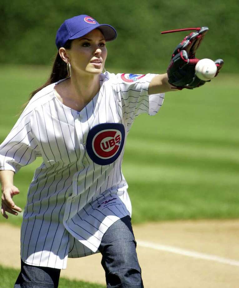 Singer Shania Twain warms up to throw out the ceremonial first pitch of the Chicago Cubs-Philadelphia Phillies game at Wrigley Field in Chicago, Thursday, July 24, 2003 Photo: ANNE RYAN, AP / AP