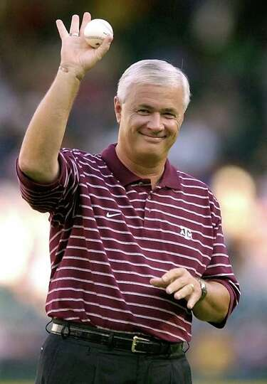 Texas A&M football coach Dennis Franchione prepares to deliver the honorary first pitch prior to the
