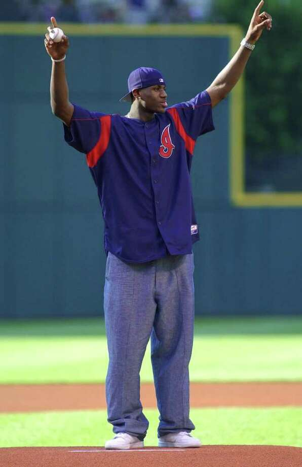 LeBron James, taken by the Cleveland Cavaliers with the first pick in the NBA draft, waves to the crowd before throwing out the first pitch at the Cincinnati Reds-Cleveland Indians game Friday, June 27, 2003, at Jacobs Field in Cleveland. Photo: JEFF GLIDDEN, AP / AP