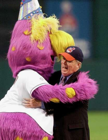 Kelly Hope, son of comedian Bob Hope, gets a hug from the Cleveland Indians mascot, Slider, after th
