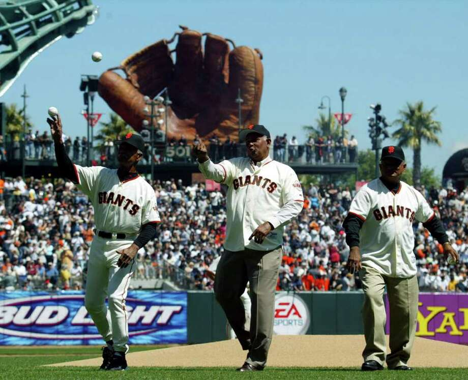 San Francisco Giants Manager Felipe Alou, left, and his brothers Jesus, center, and Matty, right, throw out the first pitch on opening day at Pac Bell park in San Francisco, Monday, April 7, 2003. Photo: ERIC RISBERG, AP / AP
