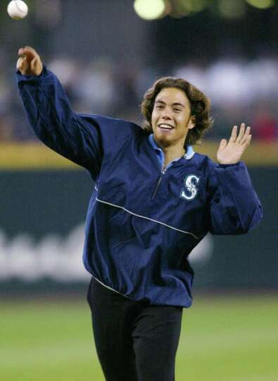 Olympic speedskater Apolo Anton Ohno throws out the first pitch before the Seattle Mariners' game ag
