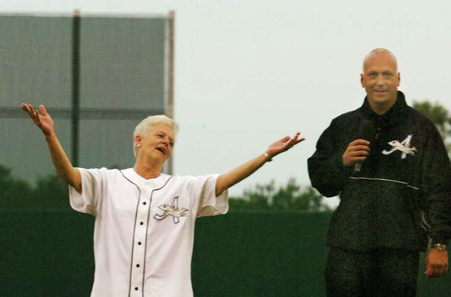 Cal Ripken, right, owner of the Aberdeen IronBirds, a Class A affiliate of the Baltimore Orioles, looks on as his mother, Vi Ripken, reacts after throwing out the first pitch prior to the teams season-opening debut against the Williamsport Crosscutters in the New York-Penn League at the new Ripken Stadium in Aberdeen, Md., Tuesday, June 18, 2002. Photo: ROBERTO BOREA, AP / AP