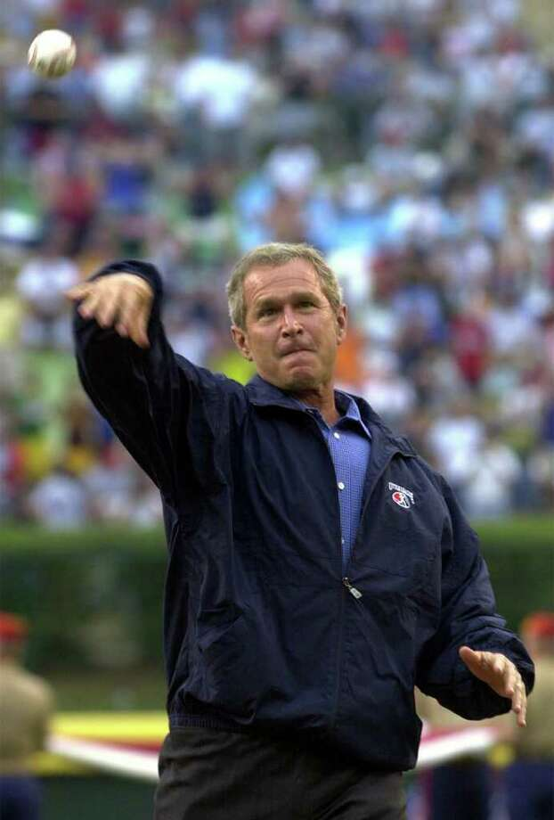 President Bush throws out the ceremonial first pitch at the start of the Little League World Series Championship game at Lamade Stadium in South Williamsport, Pa., Sunday, Aug. 26, 2001. Photo: SUSAN WALSH, AP / AP