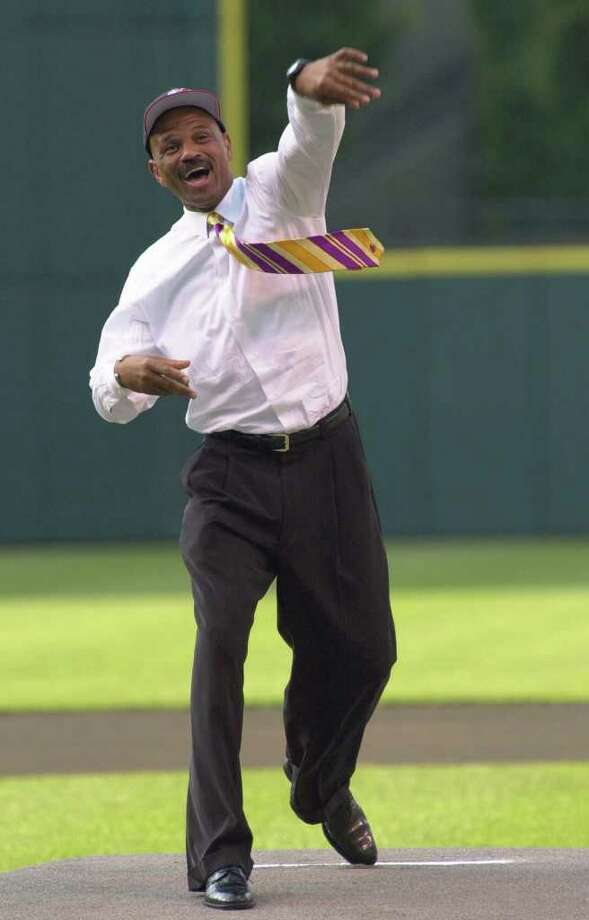 New Cleveland Cavaliers head coach John Lucas throws out a first pitch before the Cleveland Indians entertain the Minnesota Twins Tuesday, June 19, 2001, in Cleveland. Photo: JEFF GLIDDEN, AP / AP