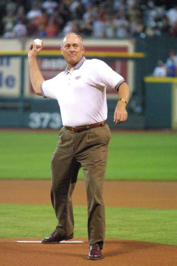 Hall of Fame pitcher Nolan Ryan throws out the first pitch Saturday, June 16, 2001, before the Houston Astros faced the Texas Rangers in an interleague game in Houston. Ryan played for both the Astros and the Rangers during his big league career. Photo: RICHARD CARSON, AP / AP