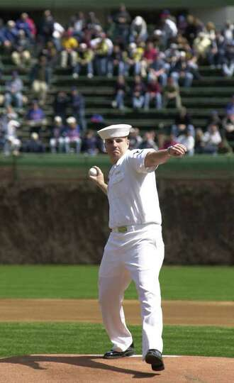 Navy Seaman Jeremy Crandall throws out the first pitch before a game between the Chicago Cubs and