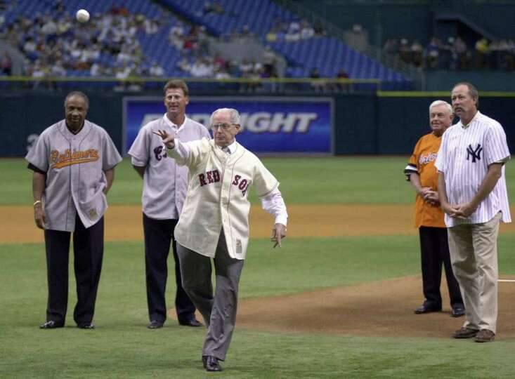 Seven-time All-Star Dom DiMaggio, center, throws out the honorary first pitch surrounded by American