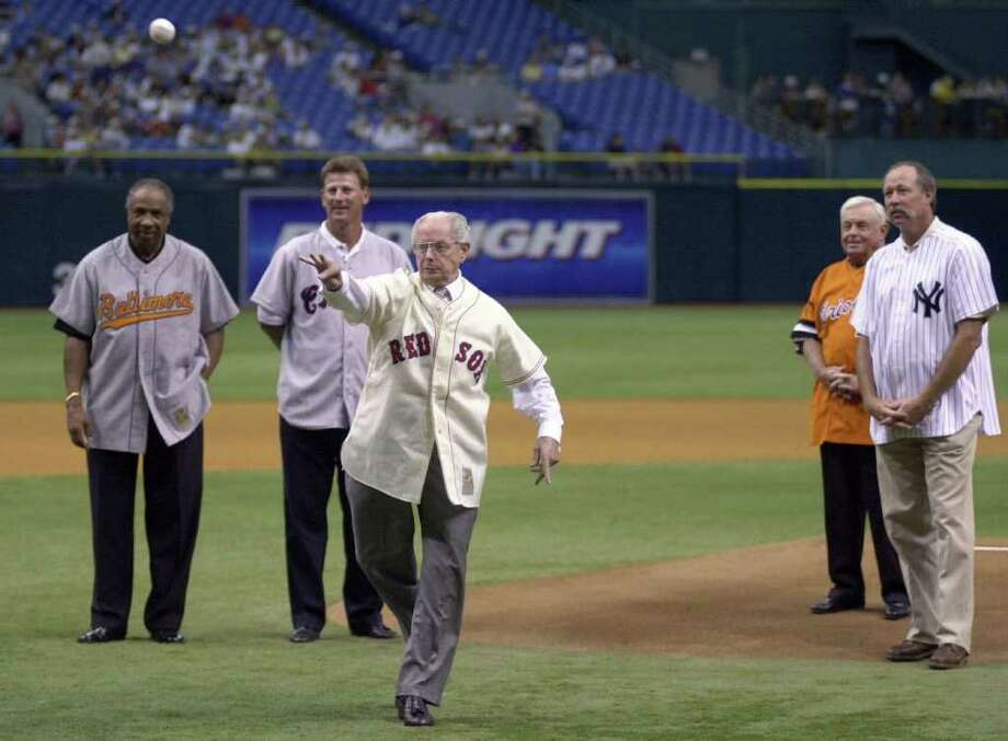 "Seven-time All-Star Dom DiMaggio, center, throws out the honorary first pitch surrounded by American League greats, from left, Frank Robinson, Bobby Thigpen, Earl Weaver and Rich ""Goose"" Gossage before the game between the Chicago White Sox and Tampa Bay Devil Rays at Tropicana Field Saturday, Aug. 12, 2000 in St. Petersburg, Fla. The ceremony celebrated the 100th aniversary of the American League. Photo: SCOTT MARTIN, AP / AP"