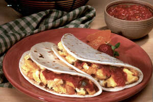 A bacon and egg taco has a moderate 230 calories, but 610 milligrams sodium. A potato and egg taco has 430 milligramssodium.