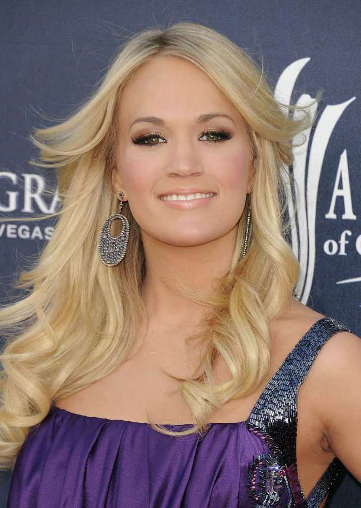 Singer Carrie Underwood arrives at the 46th Annual Academy Of Country Music Awards RAM Red Carpet held at the MGM Grand Garden Arena in Las Vegas, Nevada.