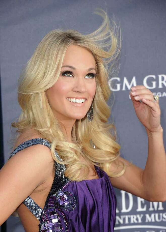 Singer Carrie Underwood arrives at the 46th Annual Academy Of Country Music Awards RAM Red Carpet held at the MGM Grand Garden Arena in Las Vegas, Nevada.  Photo: Jason Merritt, Getty Images / 2011 Getty Images