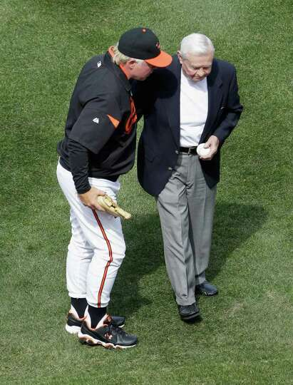 BALTIMORE, MD - APRIL 04: Buck Showalter #26 manager of the Baltimore Orioles talks with former Orio