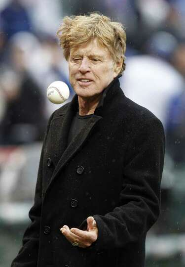 CHICAGO, IL - APRIL 01:  Actor Robert Redford gets ready to throw out the first pitch prior to the C