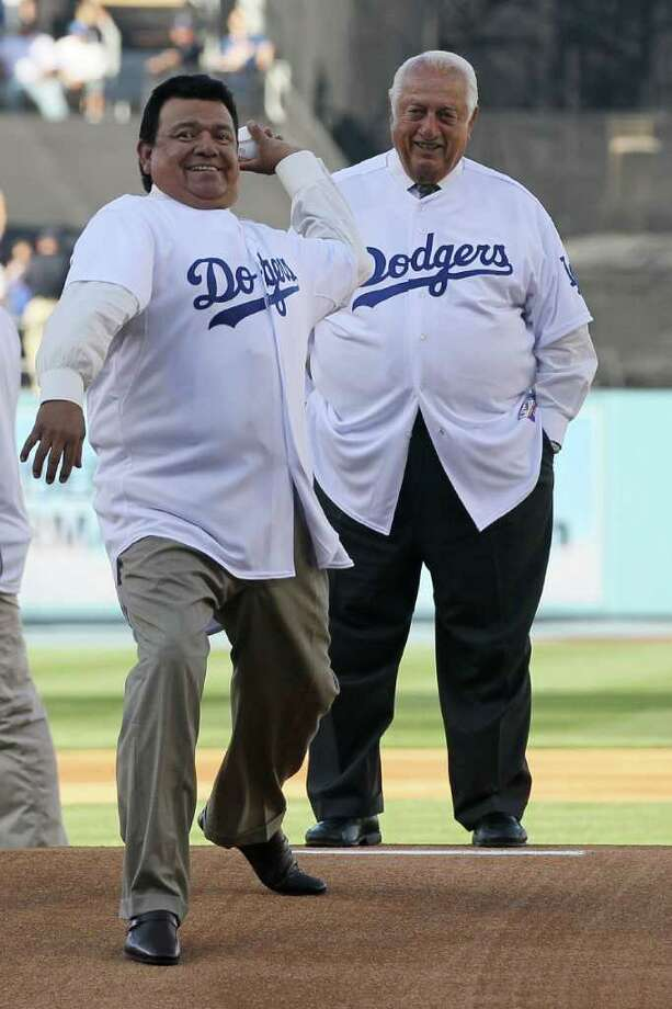 LOS ANGELES, CA - MARCH 31:  Former Los Angeles Dodgers pitcher Fernando Valenzuela throws out the ceremonial first pitch as former Dodger manager Tommy Lasorda looks on prior to the Dodgers playing the San Francisco Giants on Opening Day at Dodger Stadium on March 31, 2011 in Los Angeles, California.  (Photo by Jeff Gross/Getty Images) *** Local Caption *** Fernando Valenzuela;Tommy Lasorda Photo: Jeff Gross, Getty Images / 2011 Getty Images