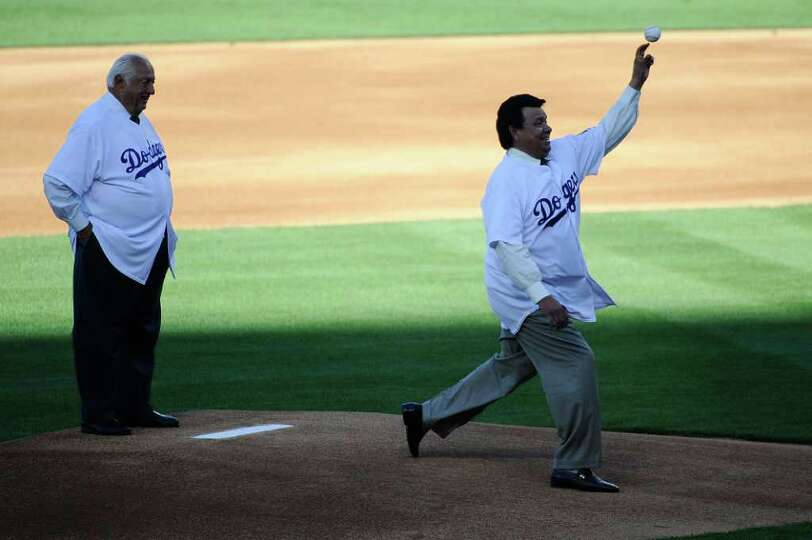LOS ANGELES, CA - MARCH 31:  Former Los Angeles Dodgers pitcher Fernando Valenzuela throws out the c
