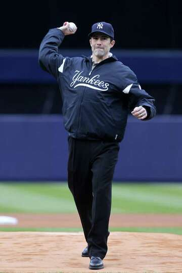 NEW YORK, NY - MARCH 31:  Mike Mussina, former New York Yankee, throws the ceremonial first pitch be