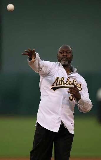 OAKLAND, CA - APRIL 01:  Former Oakland pitcher Dave Stewart throws out the first pitch before the O