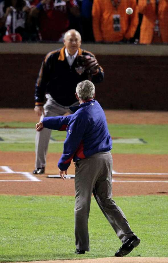 ARLINGTON, TX - OCTOBER 31:  Former President of the United States, George W. Bush, throws out the ceremonial first pitch to former MLB pitcher, Nolan Ryan, before the Texas Rangers host the San Francisco Giants in  in Game Four of the 2010 MLB World Series at Rangers Ballpark in Arlington on October 31, 2010 in Arlington, Texas.  (Photo by Doug Pensinger/Getty Images) *** Local Caption *** George W. Bush;Nolan Ryan Photo: Doug Pensinger, Getty Images / 2010 Getty Images