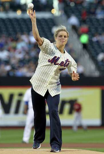 NEW YORK - AUGUST 27:  Tennis player Kim Clijsters throws the ceremonial first pitch of the game bet