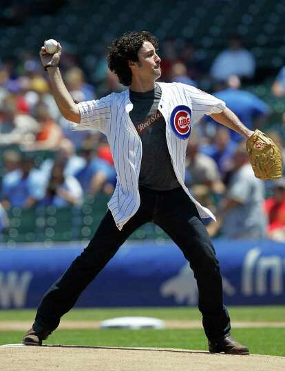 CHICAGO - JUNE 30: Actor Thomas Ian Nicholas throws a ceremonial first pitch before the Chicago Cubs