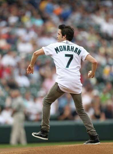SEATTLE - JULY 09: Lead singer Pat Monahan of the musical group ''Train'' throws out the ceremonial