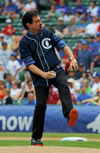 CHICAGO - JUNE 20: Actor Joe Mantegna throws out a ceremonial first pitch before the Chicago Cubs ta
