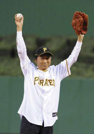 Japanese Prime Minister Yukio Hatoyama throws the ball during the ceremonial first pitch in the Majo