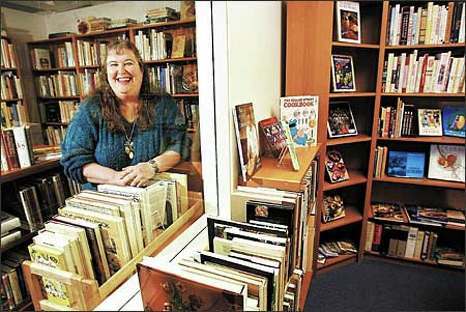 Maggie Garrett spent years in Alaska as a cook at various sites, raising enough of a stake to open her storefront cookbook shop, the only one of its kind in Seattle. Photo: Dan DeLong, Seattle Post-Intelligencer / Seattle Post-Intelligencer