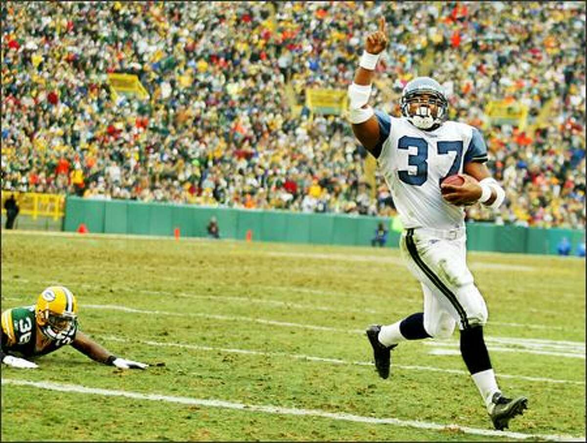 Shaun Alexander points to the sky after setting the NFL's single-season touchdown record.