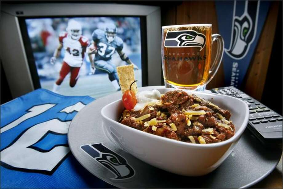 Belly up to the TV and the Seahawks' playoff game versus the Redskins with a hefty bowl of John Howie's Texas Chili. This big and beefy concoction can really take a hit. Photo: Andy Rogers, Seattle Post-Intelligencer / Seattle Post-Intelligencer