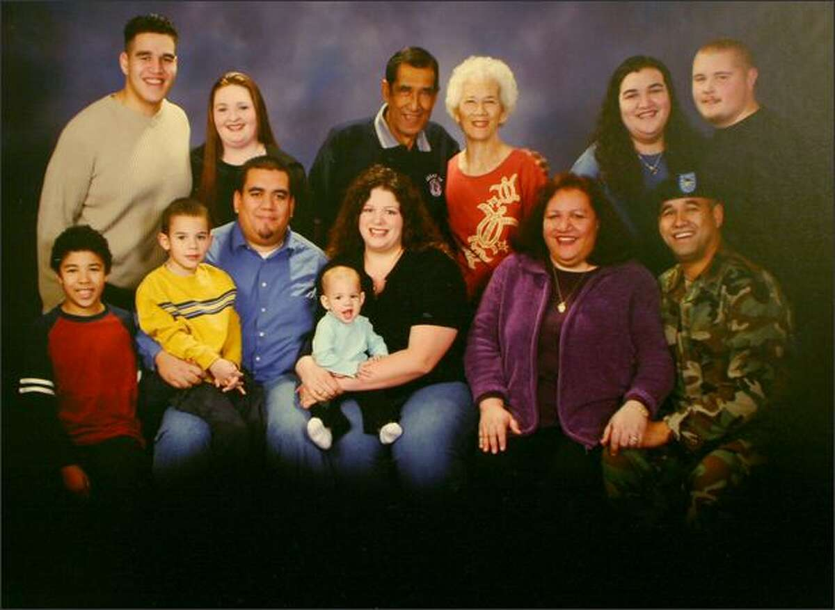 This portrait of Garry Naipo and his extended family was taken just before he left for Iraq in January 2004, when his National Guard unit was deployed. Alii Naipo says her husband came home from Iraq